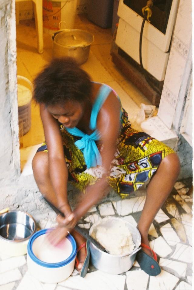 Salome making fufu for dinner in Kinshasa, DRC