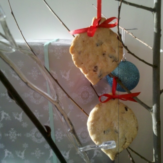 Christmas biscuit baubles hanging from a tree