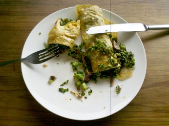 Rolled omelette stuffed with kale, mushrooms and marinaded Meredith goat cheese