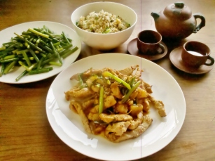 Sweet and sour pork served with egg fried rice and stir fried garlic shoots