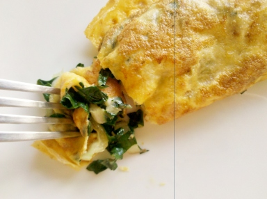 Rolled omelette stffed with silverbeet and cheese