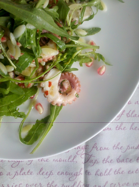 Octopus, pomegranate and rocket salad