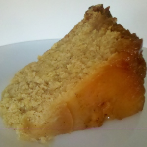A slice of moist apple upside down cake