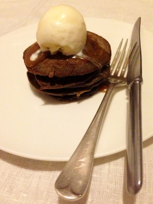Buckwheat pancake stack topped with salted caramel sauce and truffle oil and honey ice cream.
