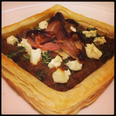 Caramelised leek tart with bacon, goat cheese and thyme
