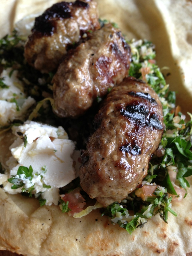Lamb kofte with tabbouleh and labne in pita