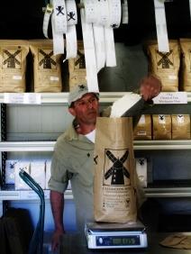 Filling flour bags at the Callington Mill