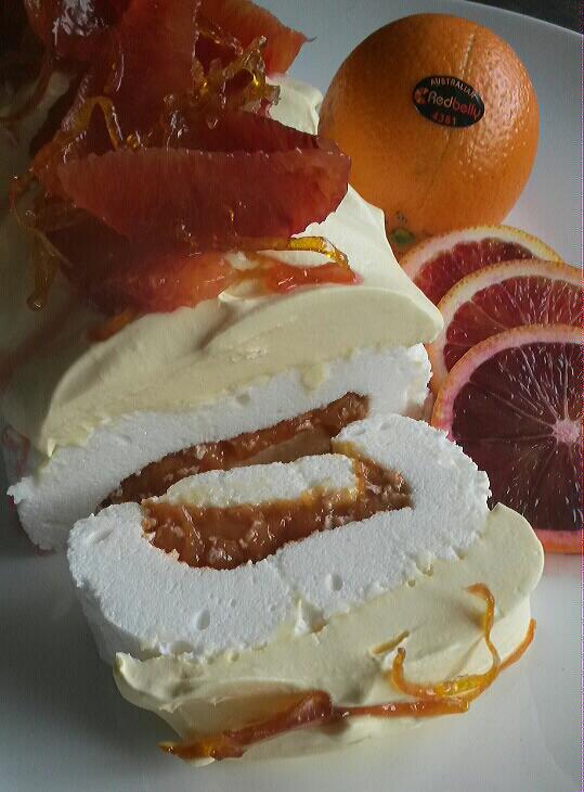 Blood orange pavlova roll