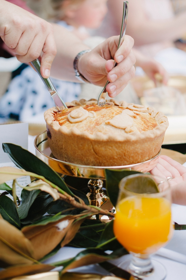 Cutting into the chicken and ham pie (photo by Pobke Photography)
